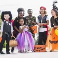 multi-ethnic-group-of-children-in-halloween-costumes-607884626-59b2efe59abed50011aa3ca8